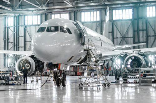 Aerospace Industry - Passenger aircraft on maintenance of engine and fuselage repair in airport hangar
